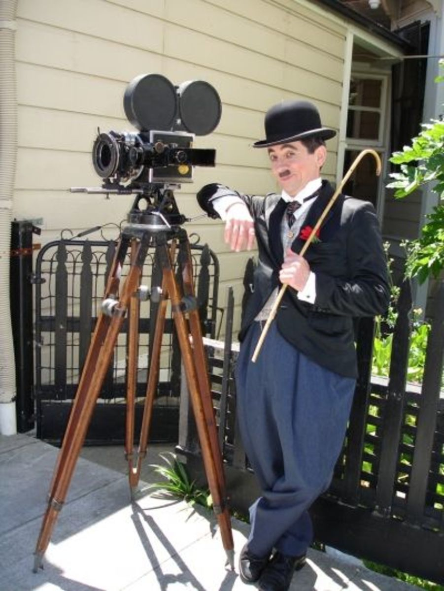"""Charlie Chaplin"" posing next to vintage handcranked camera - Charlie Chaplin Day June 2006"