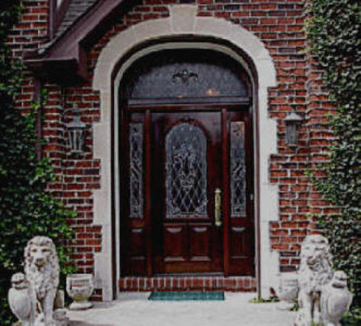 Traditional Front Door with sidelight, arch and leaded glass and a new twist - a curved transom