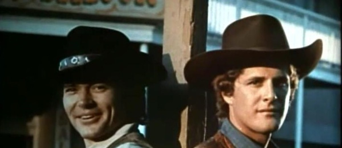 A still photo taken from the opening sequence showing Pete Duel as Hannibal Heyes and Ben Murphy as Kid Curry