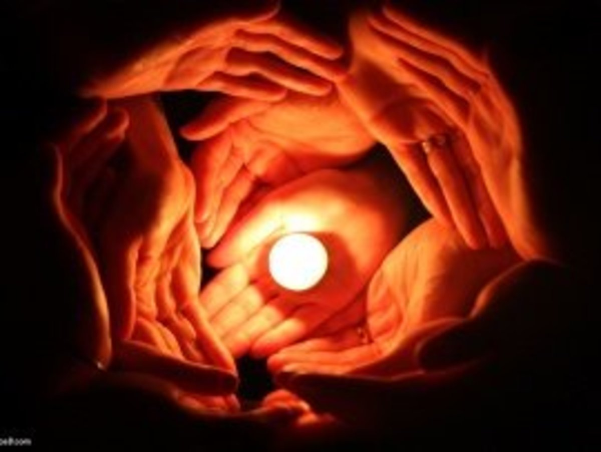 Candle Surrounded with many hands