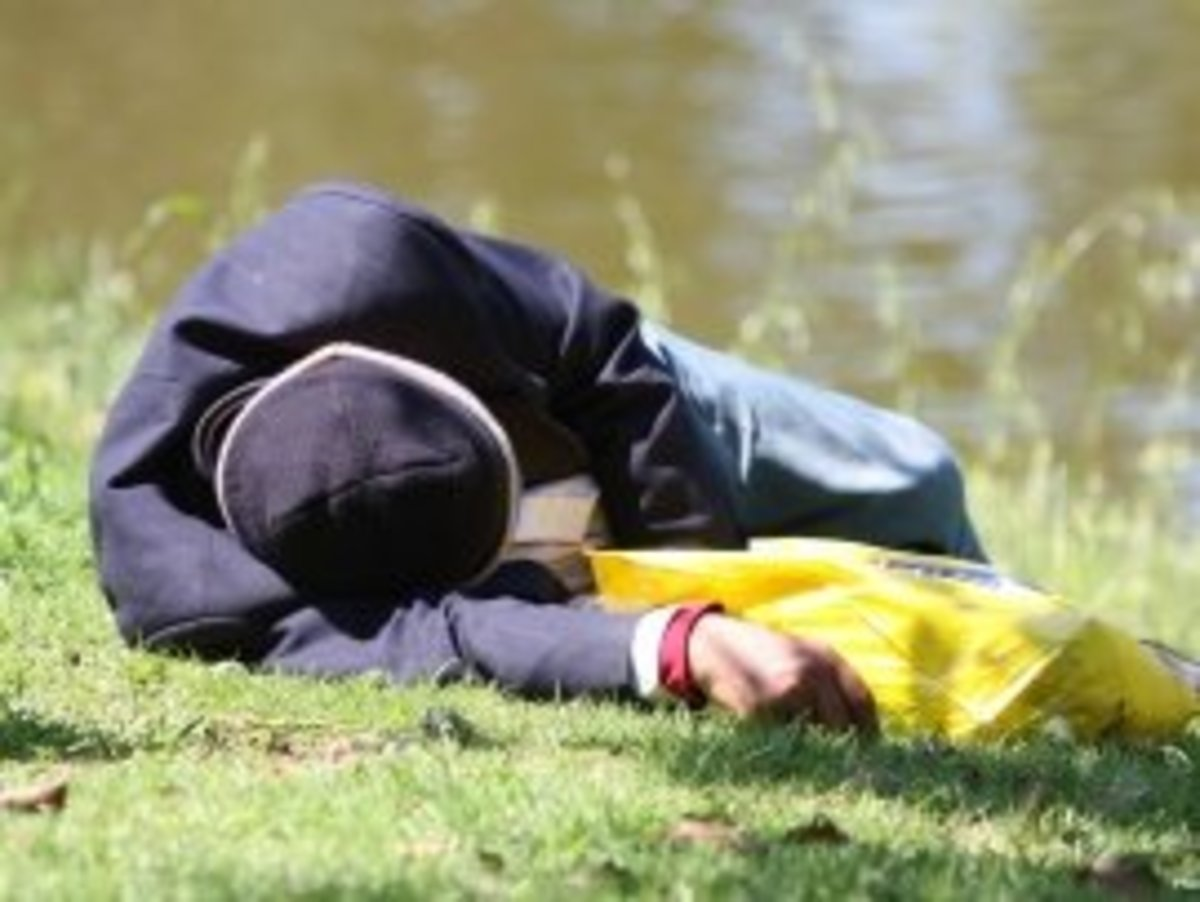 Man Asleep in Park - Courtesy of www.Photo8.com