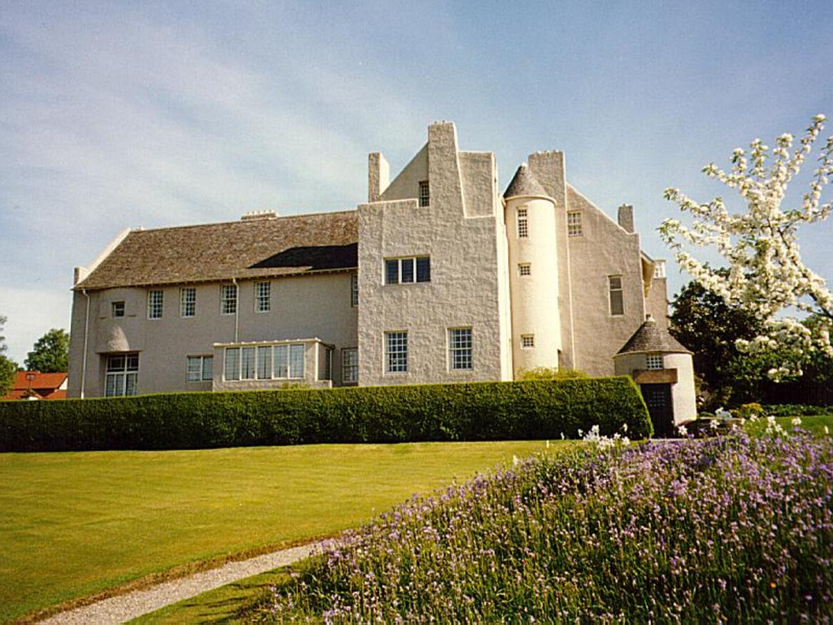 The protruding round turrets and towering chimneys of Hill House allude to the Scottish Baronial Style influence.