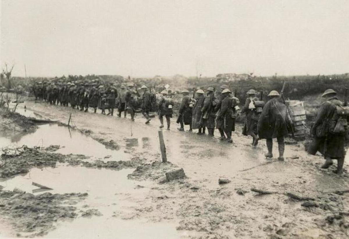 Just another rainy day on the way to the trenches, where they learned that the German blokes had been trained the same way as them.