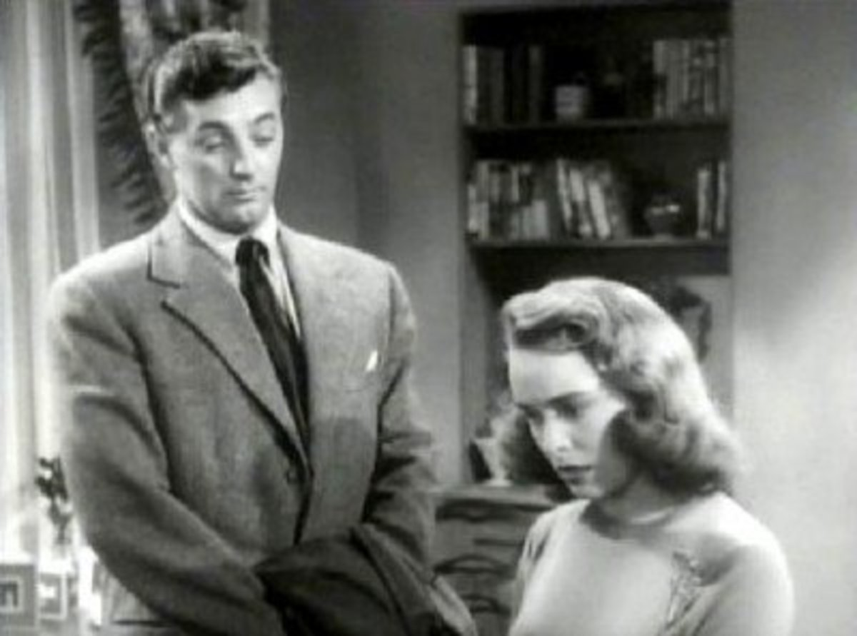 "Robert Mitchum and Janet Leigh in ""Holiday Affair."""