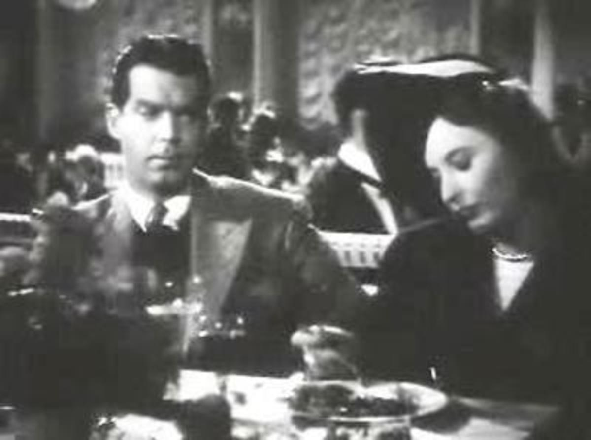 "Fred MacMurray and Barbara Stanwyck in ""Remember the Night."""
