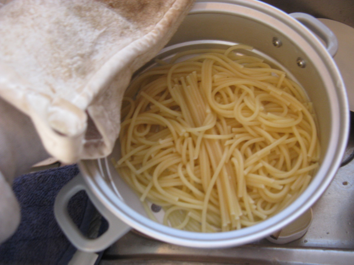 Strain pasta into the steamer basket and splash with olive oil.