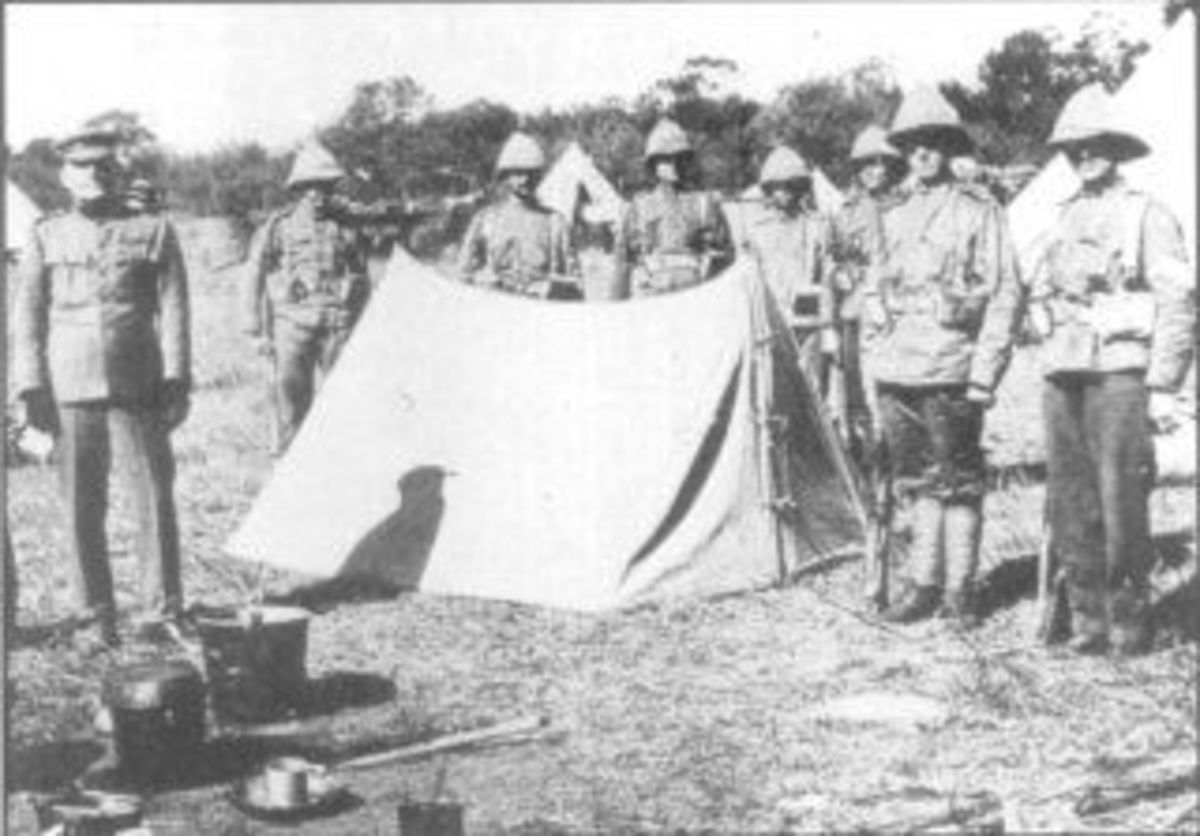 Men of the Durban Light Infantry stand guard over Bhambatha's body. (Photo: Transvaal Leader Weekly Edition, 30 June 1906).