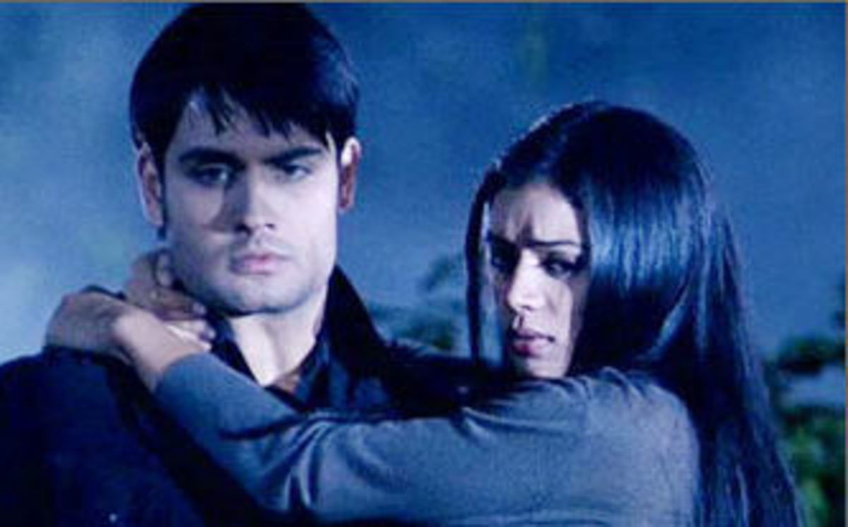 Abhay carrying Piya through the Jungle