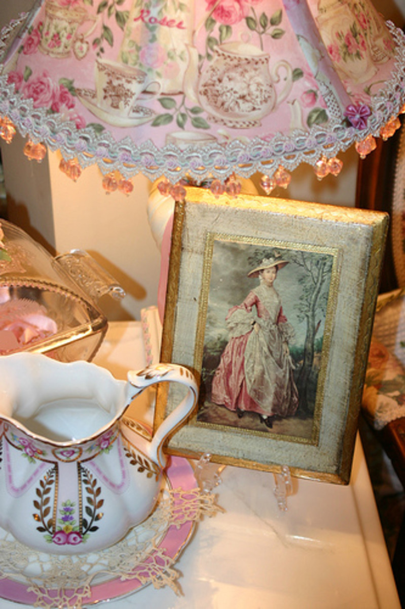 Groupings of antiques, silver, frames and eclectic items are hallmarks of the shabby chic style.
