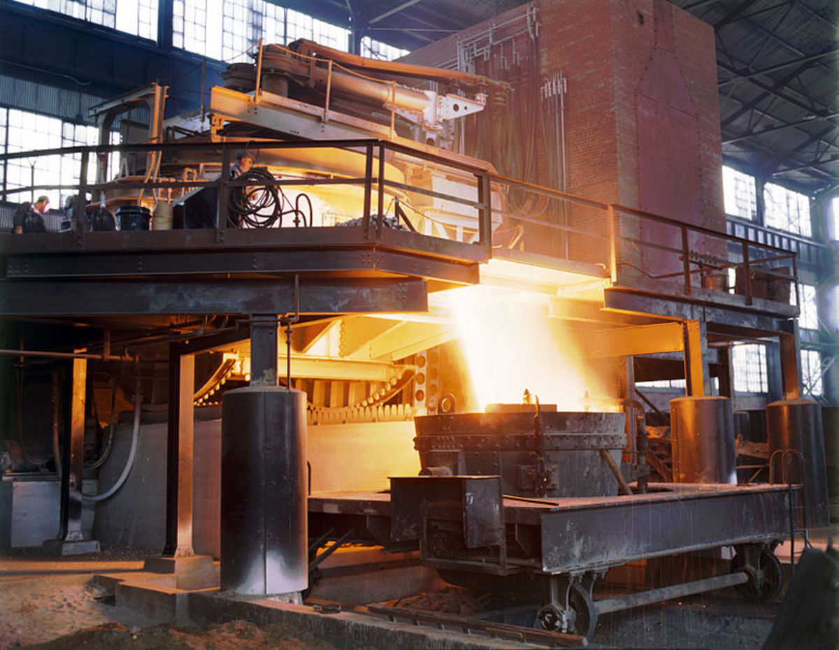 Hot steel pouring out of furnace.