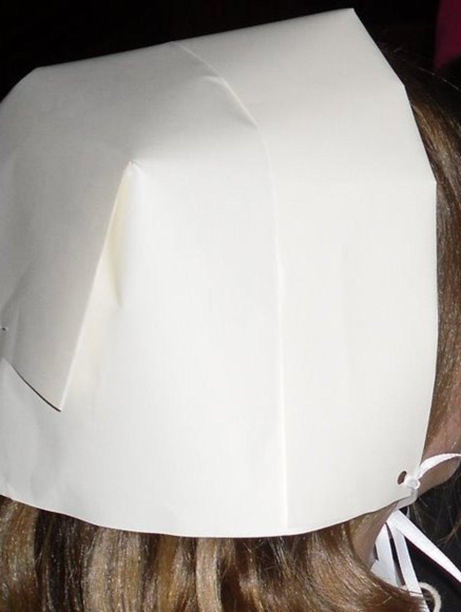 Head bonnets for the lady pilgrims