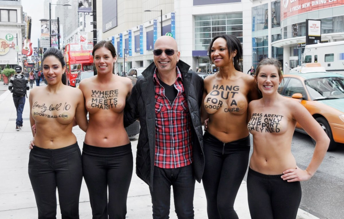 Howie Mandel while shopping downtown Toronto posed with the Rethink Breast Cancer ladies promoting BoobyBall 10