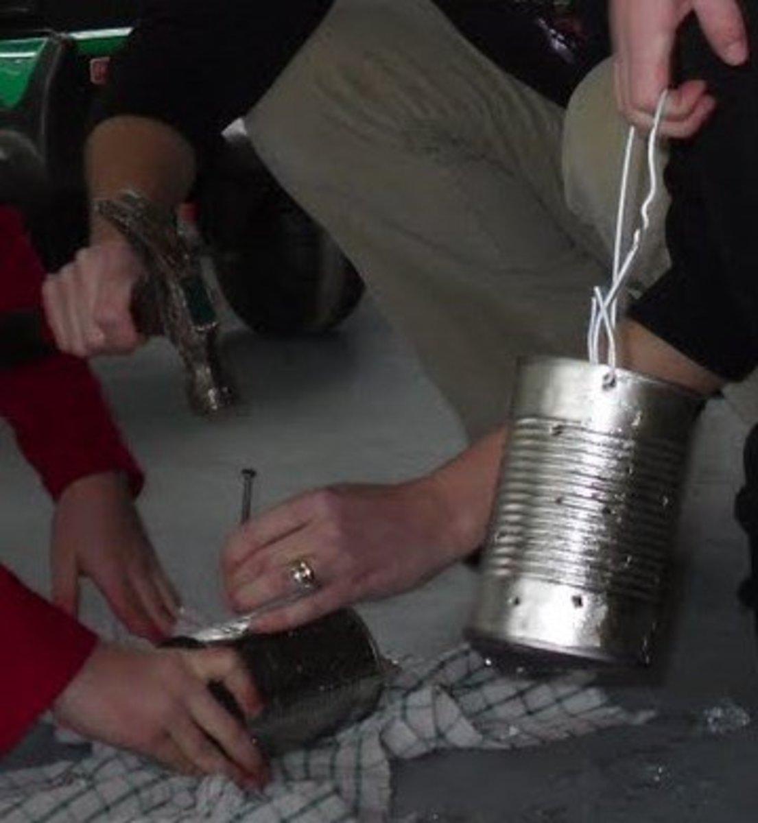 Making tin can lanterns