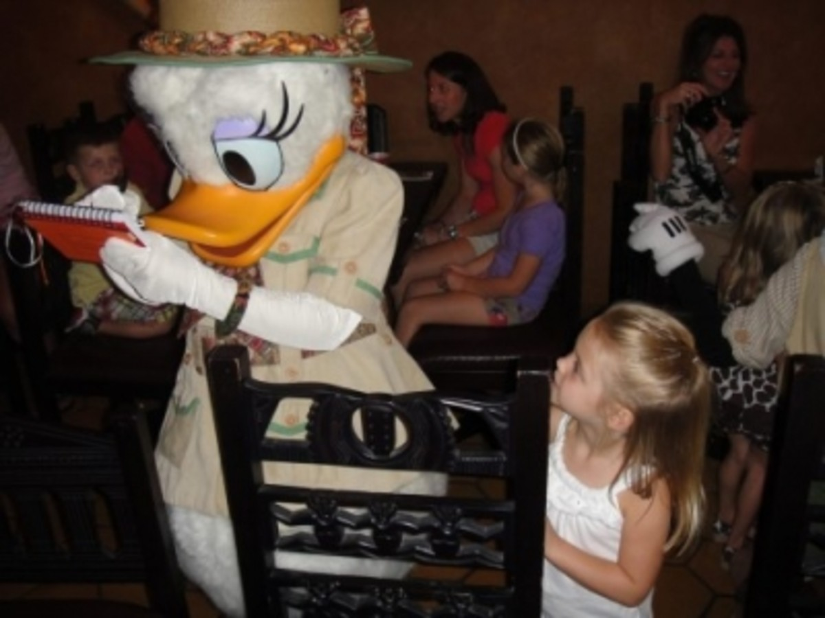 Daisy Duck is happy to sign the memory book.