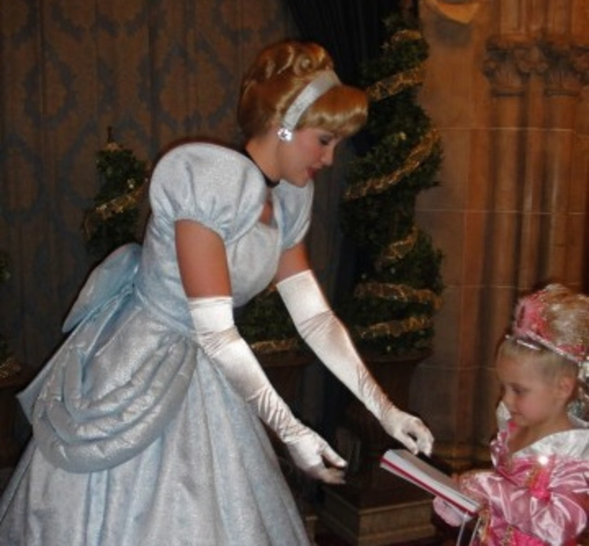 Cinderella Giving an Autograph to a little princess.