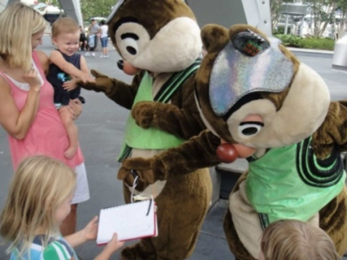 Chip and Dale signing an Autograph at Disneyworld