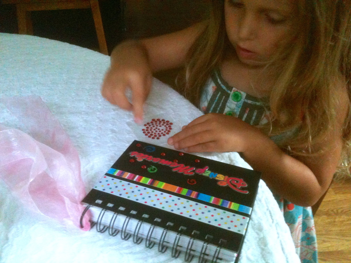 Let your child help decorate the Disney Memory book.
