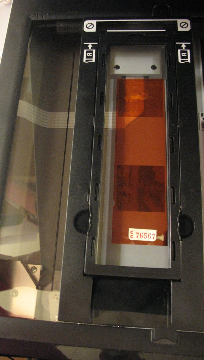 Use the film tray to align the negative in the scanning area.