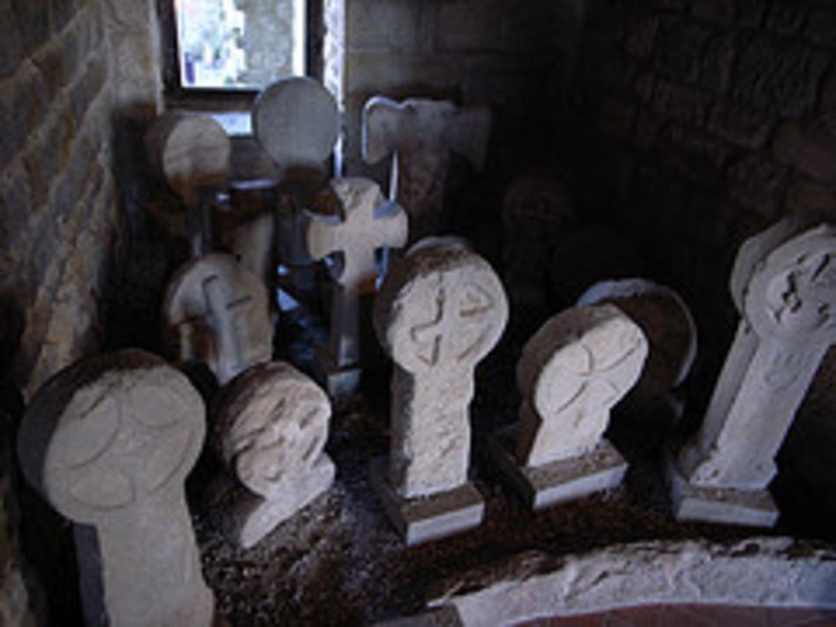 Cathar gravestones with their distinctive cross heads.