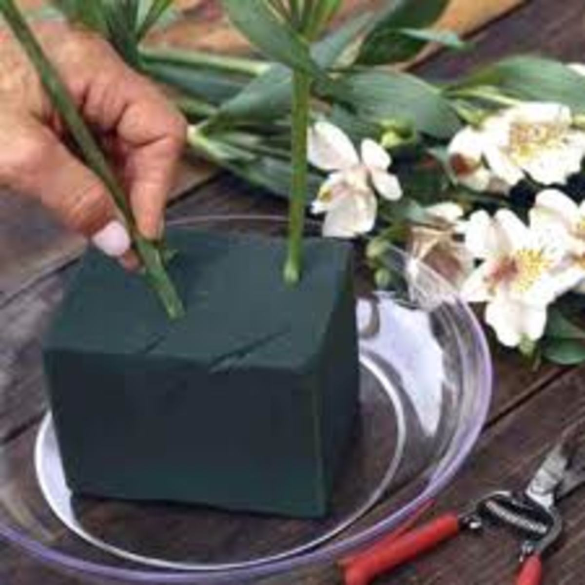This is floral foam often used in an arrangement. It must be kept damp at all times or your flowers will wilt