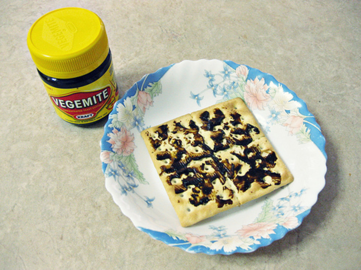 Vegemite on the classic Aussie square cracker - Saladas!  A bit of a thicker spread of margarine or butter and some cheese goes well with this kind of cracker/biscuit to add enough thickness to make a Salada 'sandwich' using 2 Saladas.