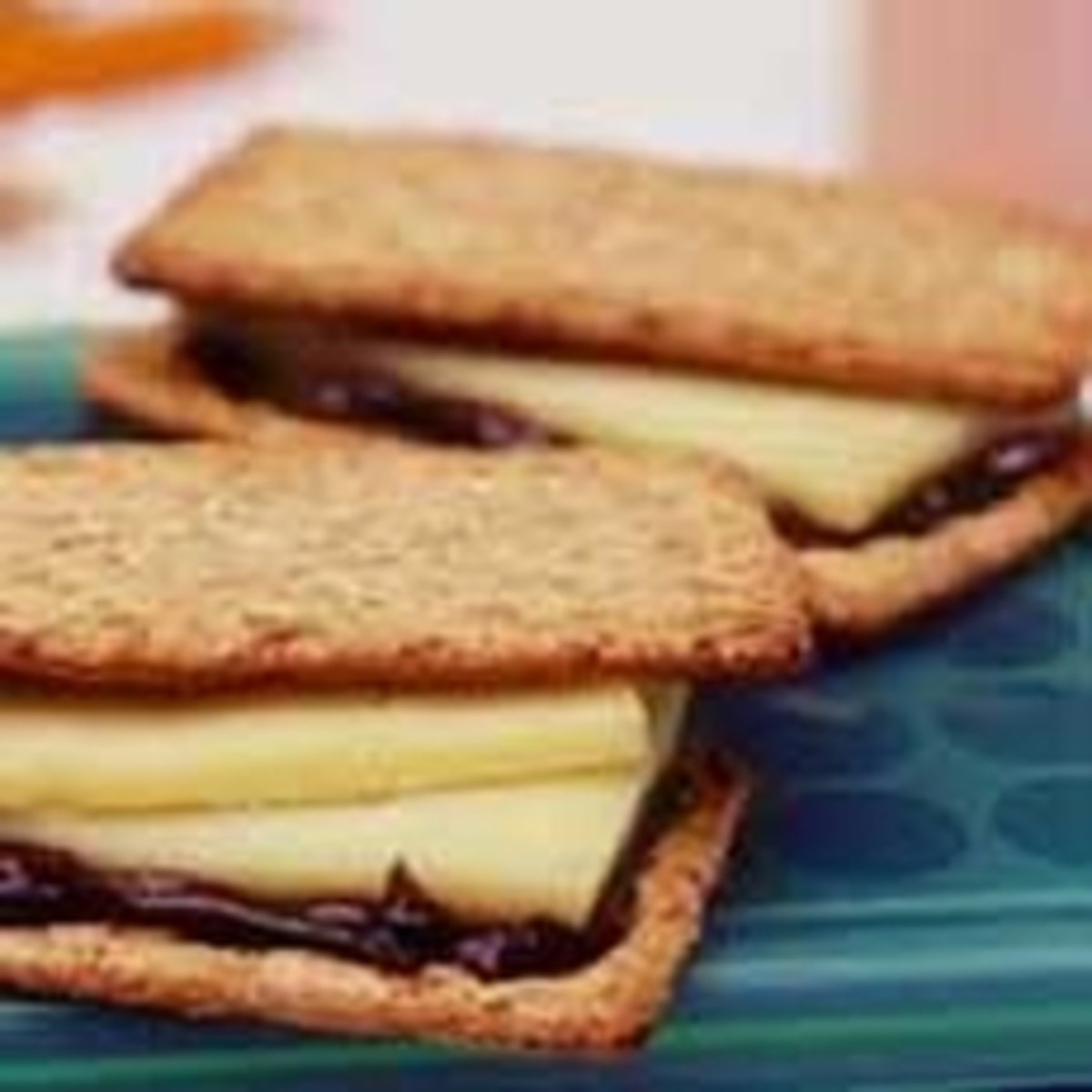 Vegemite and cheese on rye wheat crackers