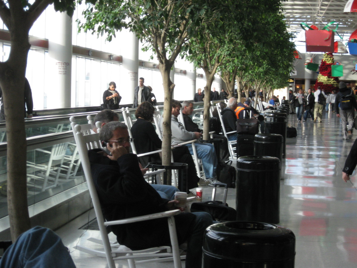 Travellers relax in rocking chairs at CLT, NC