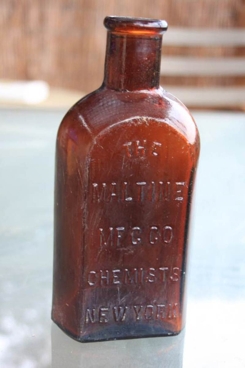 An old Maltine bottle .