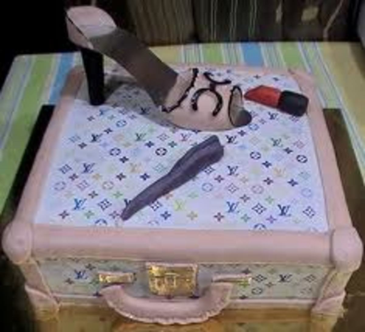 This cake is definitely for a fashionista mimicking both Chanel and Louis Vuitton this is a signature in it's own right. I love it.