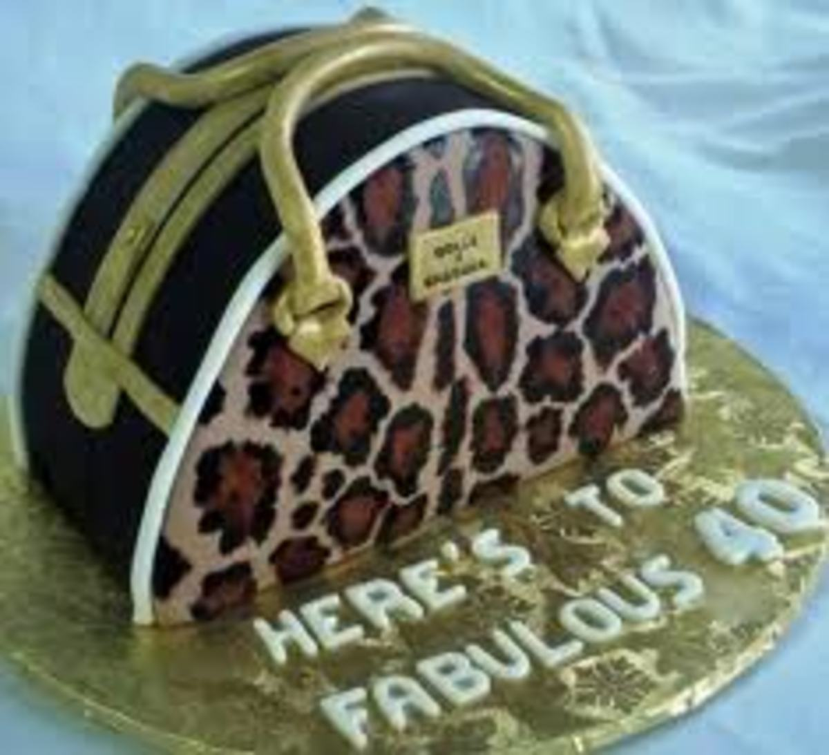 This cake is a mimic of thedesign of the Dolce and Gabbana Handbag Miss Biz purse. It was prepared by AJ's Moonlight Bakery.