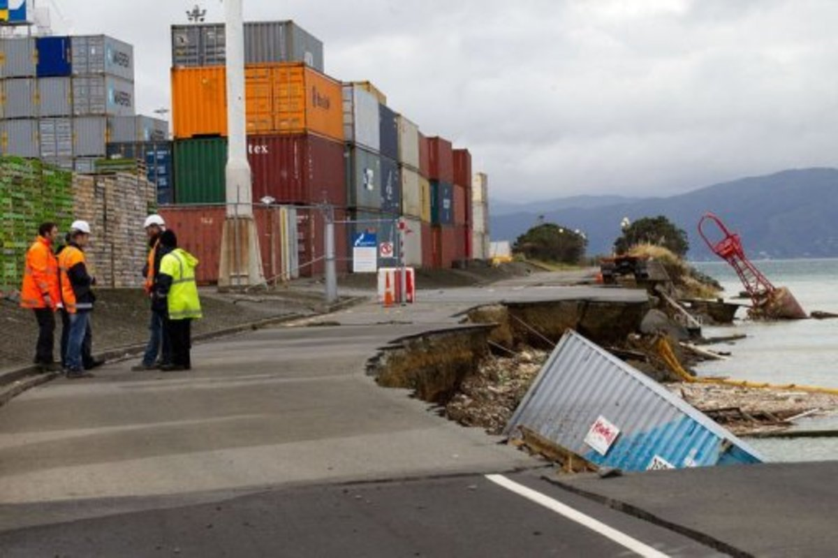 An empty shipping container sits in the harbour where the land fell into the sea, on July 22, 2013 (AFP, Marty Melville)