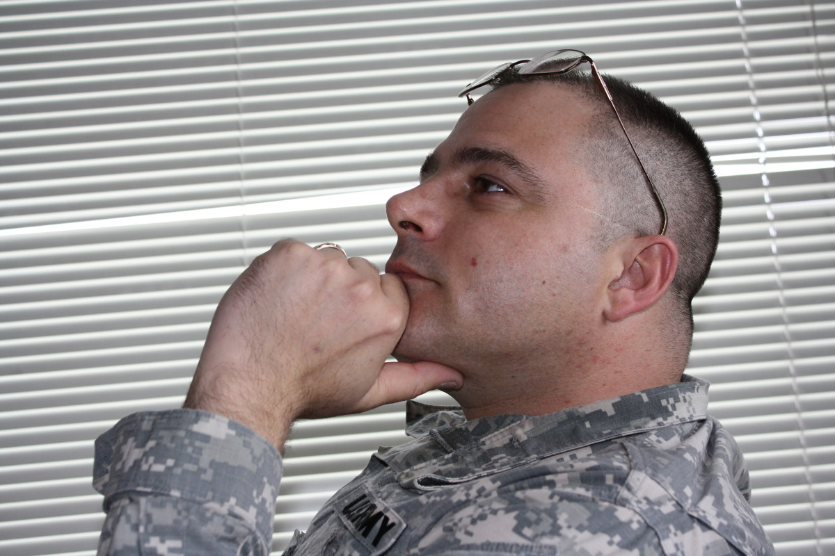 Army Recruiter listening to an applicant's story.