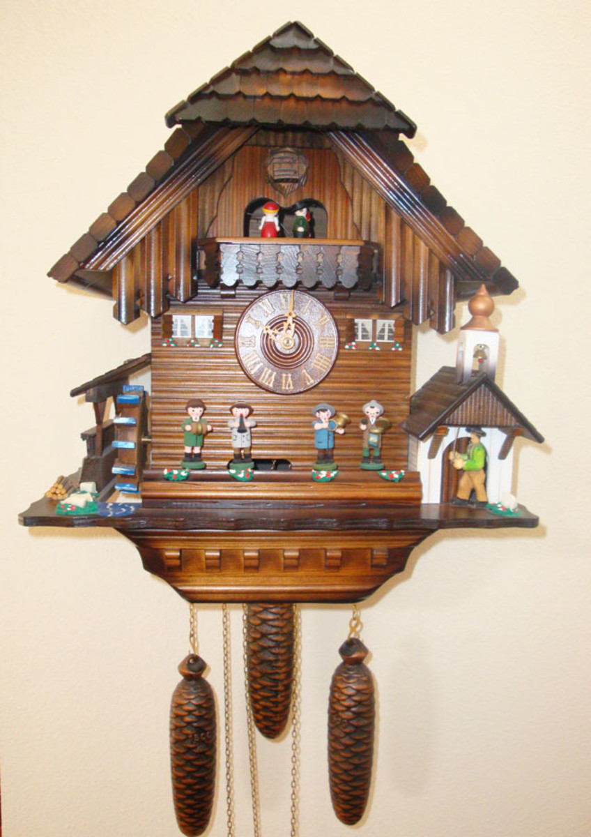 The Black Forest Chalet Cuckoo Clock is made of stained linden wood.