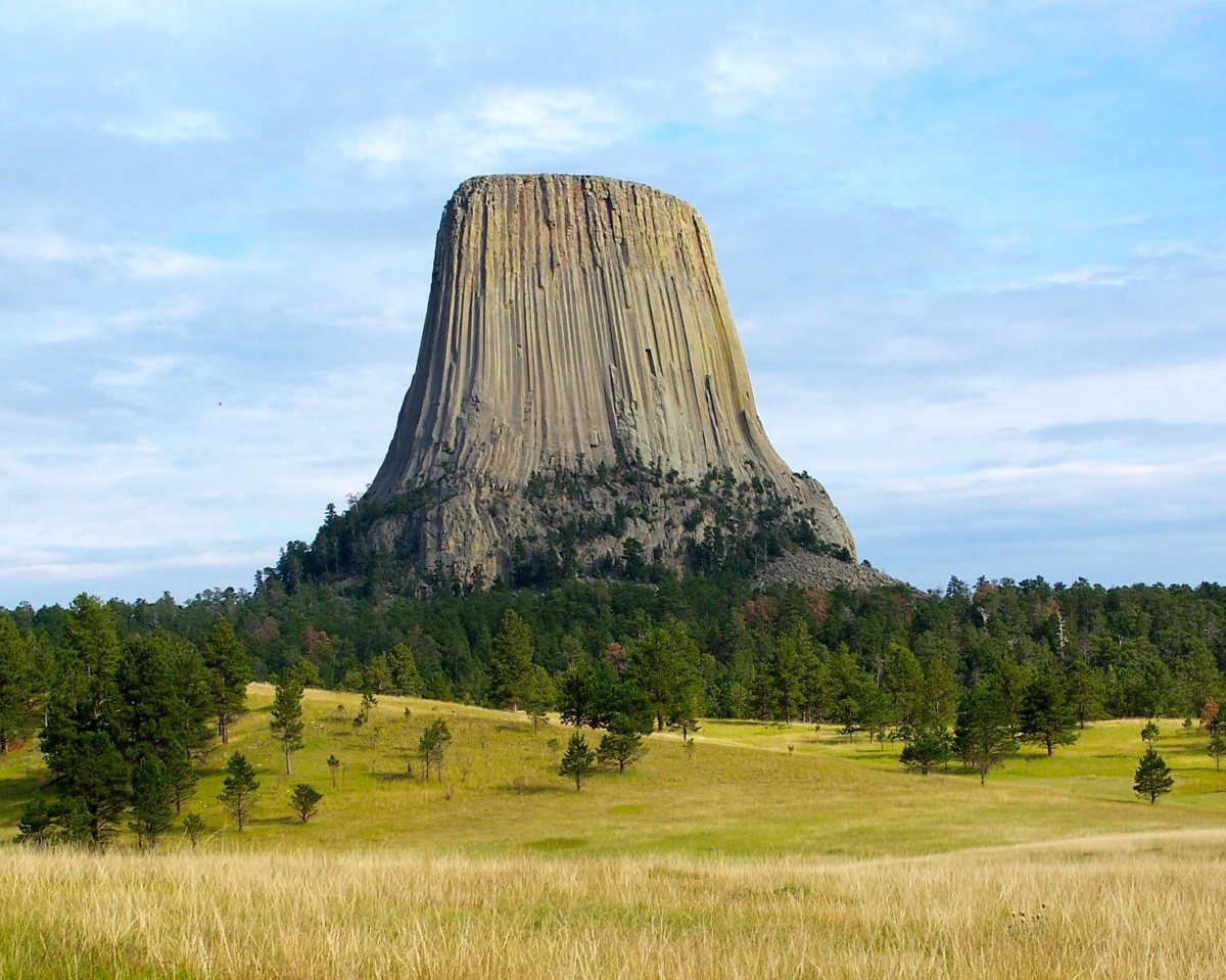 Devils Tower rises up from the prairie.