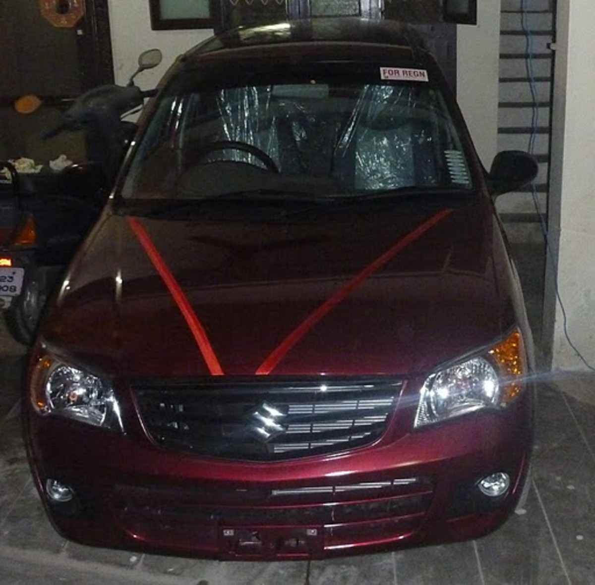 Alto K10 vxi full front view - color fire red.