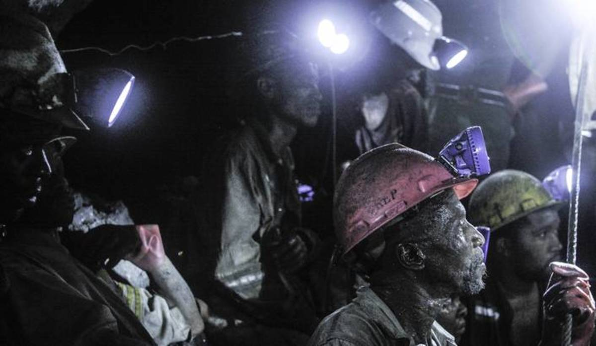 """""""The mining industry and strike wave: What are the causes and what are the solutions?"""", blaming the Marikana violence on the migrant labour system. Living and working conditions in the mines have hardly changed in 20 years, he told the audience, as y"""