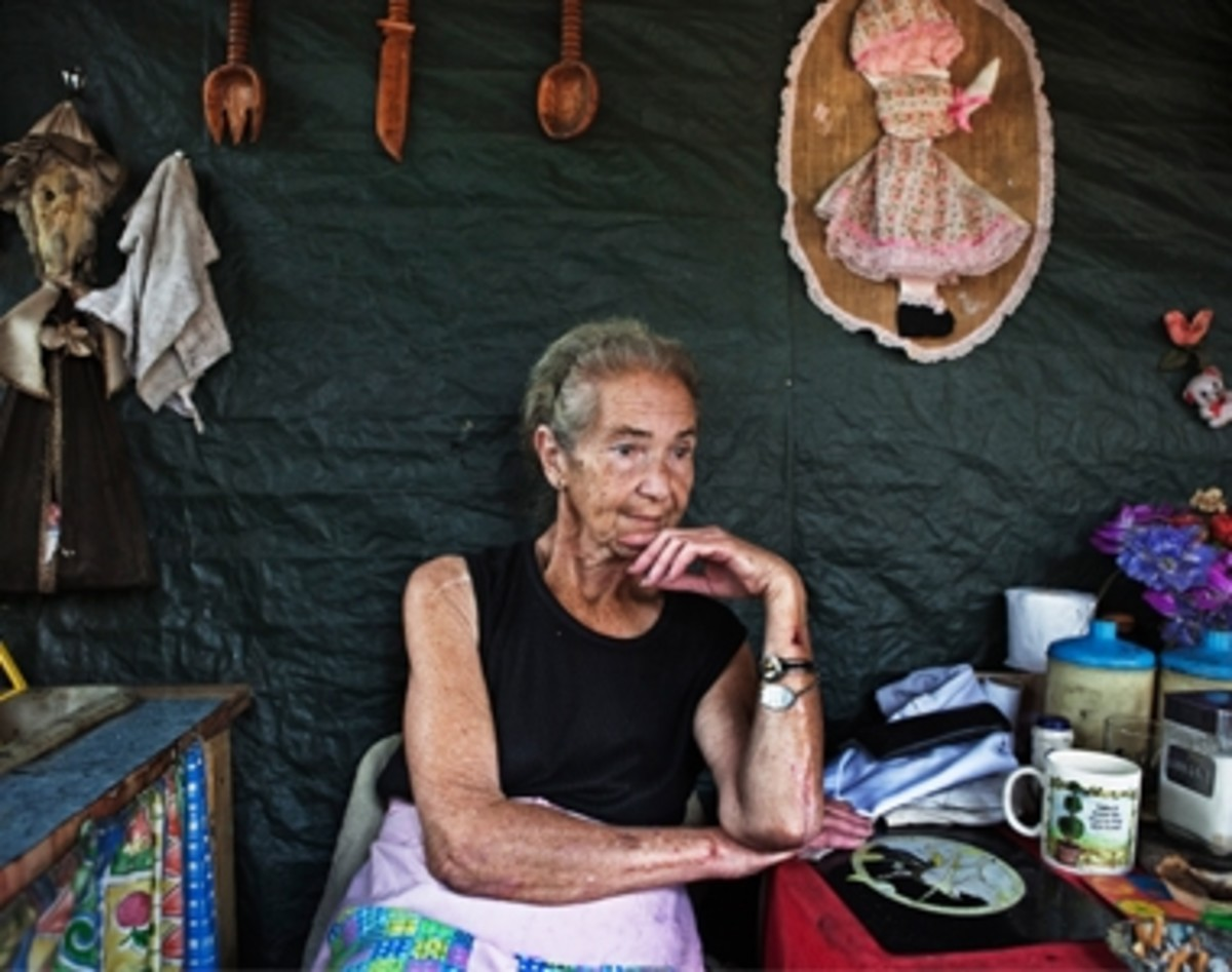 Mara Udwesthuizen, 64, sits outside her tent home at a squatter camp for poor White south African at Coronation Park in Krugersdorp