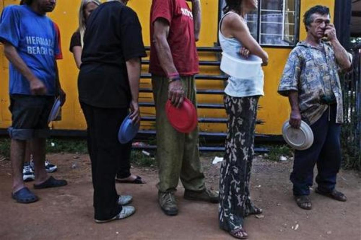 Poor Whites, in South Africa, lining up for some food