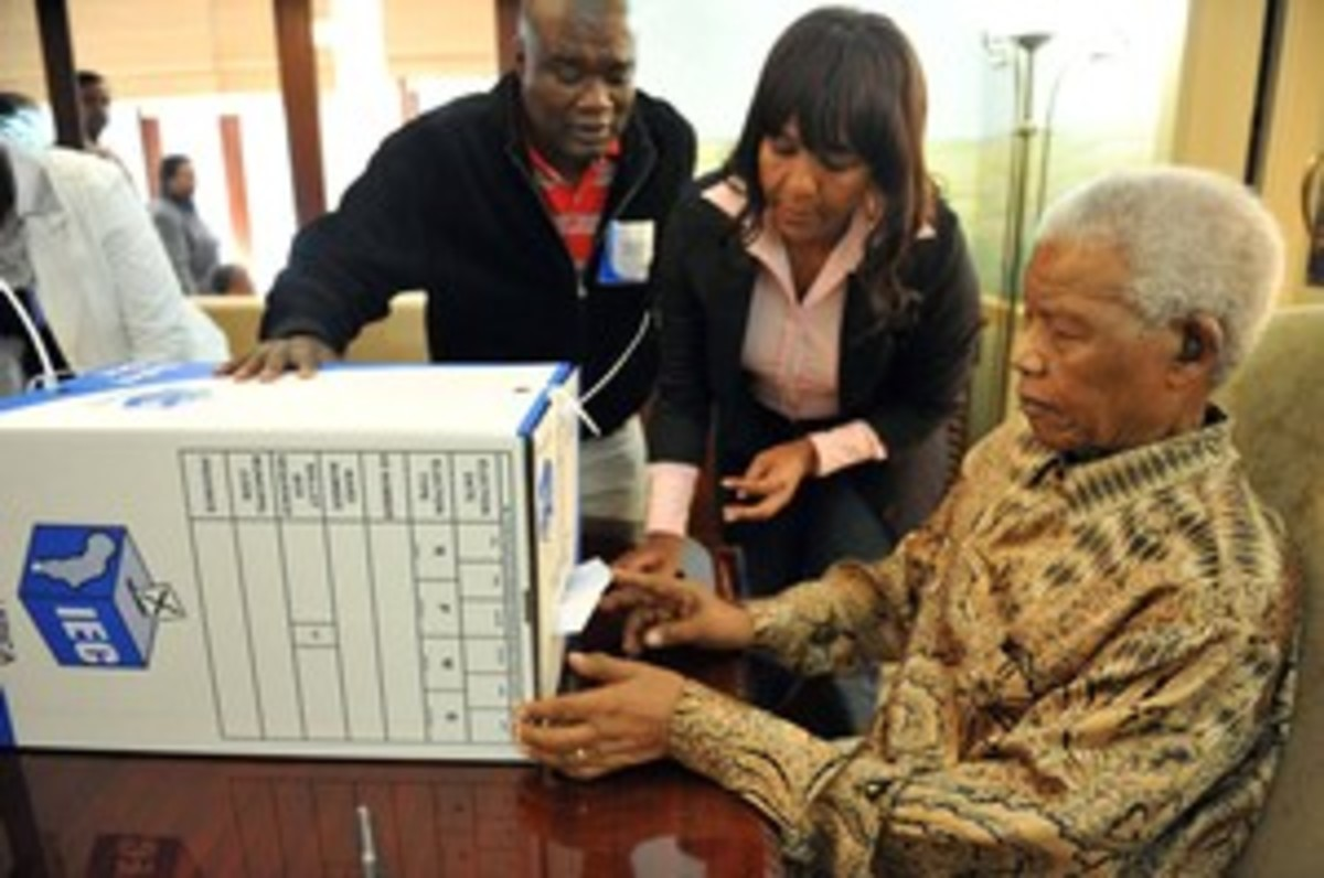 Mandela casting his vote at home assisted by his granddaughter, Ndleka Mandela, and the IEC President Officer Mr. Mshali,in his home in Houghton, Johannesburg.