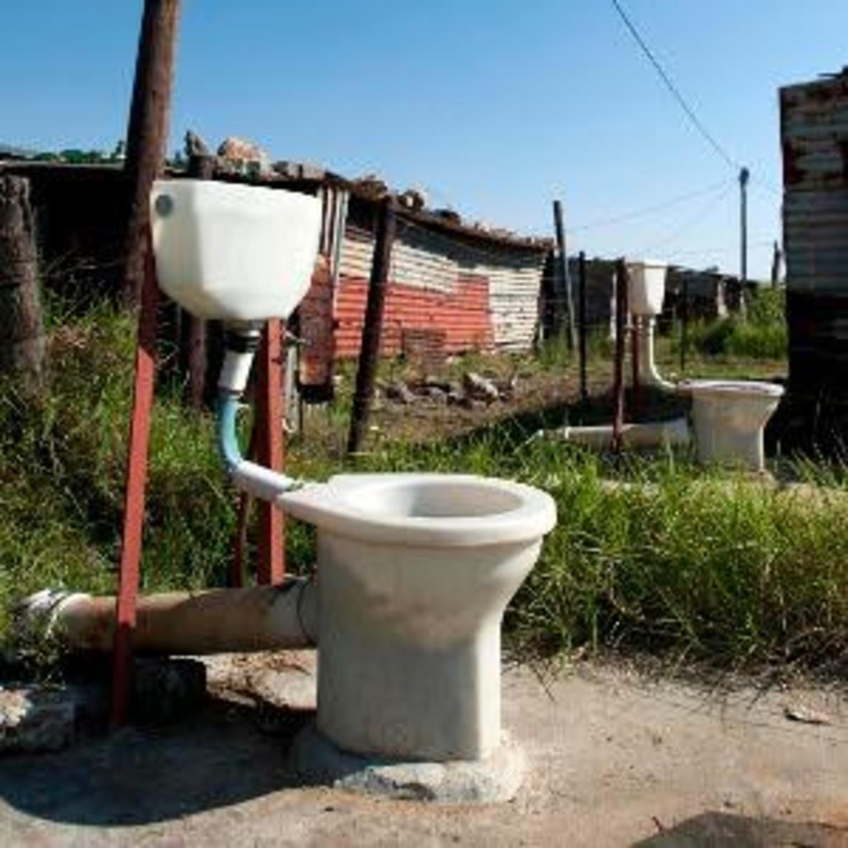 Toilet tenders stink because the people they were built for complain that they were left as seen on this picture. These are the unclosed toilets in Rammulotsi, near Viljoenskroon in the Free State, South Africa