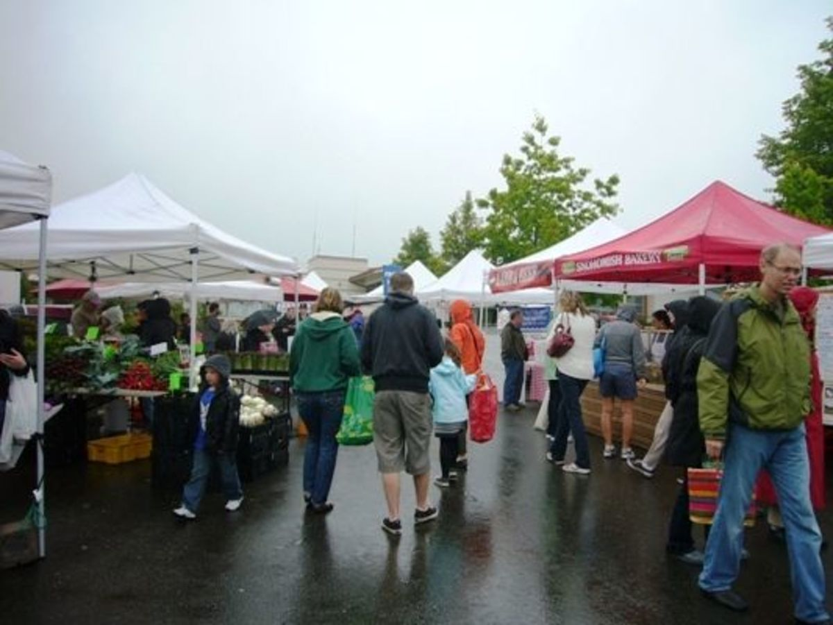 The Edmonds Farmer's Market is popular on a rainy day in June.
