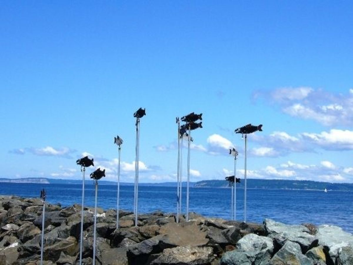 Metal Fish Sculptures on the breakwater next to the fishing pier