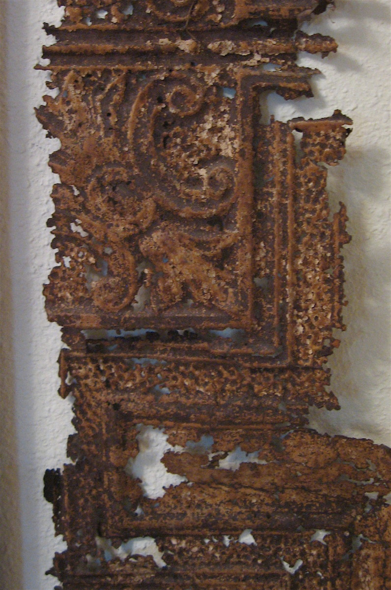 Rusty piece of tin ceiling.