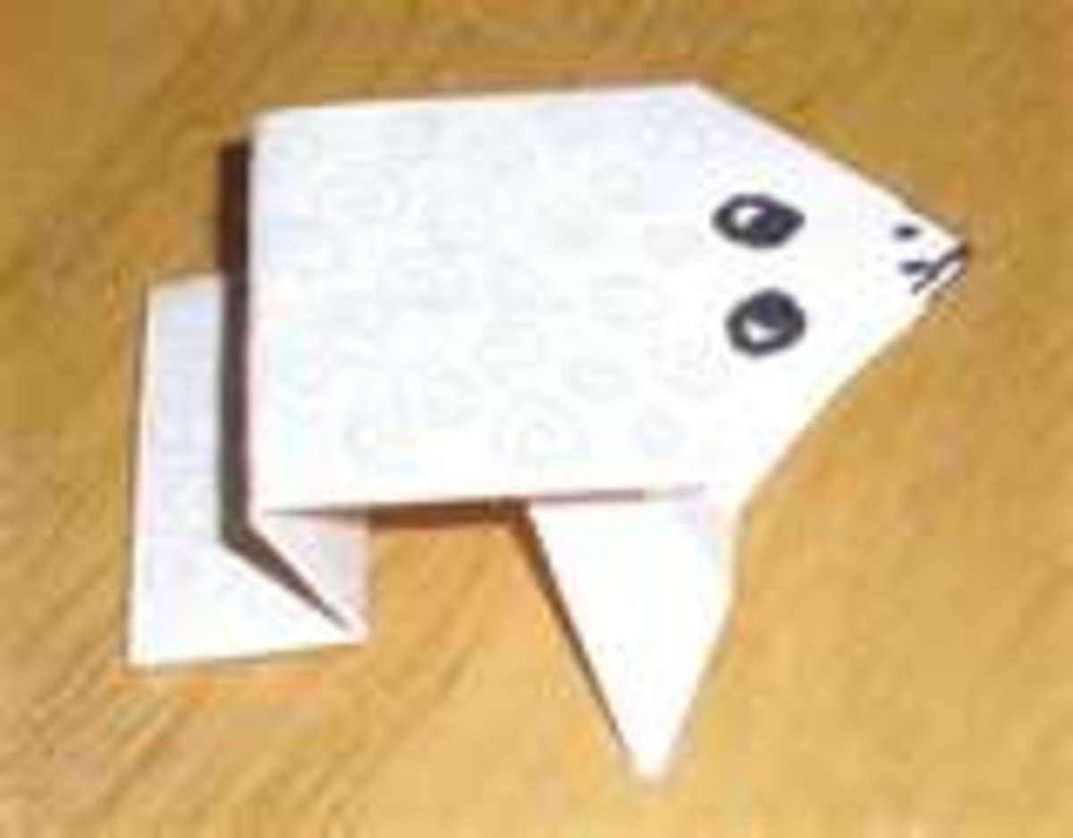 Origami frog close up made with white paper