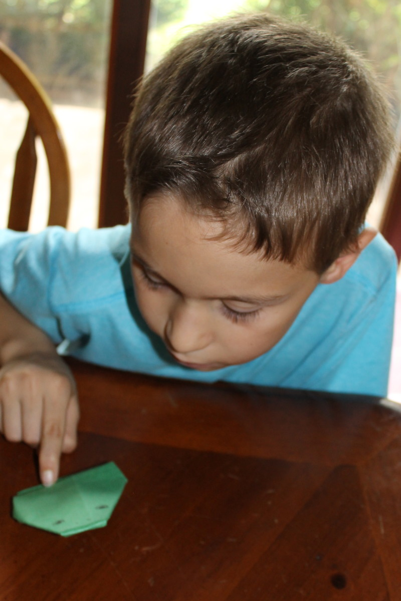 "You can also make the origami frog using green copy paper (what can be used in printers).  We learned the hard way that using construction paper makes a ""lethargic"" frog that does not jump as well."