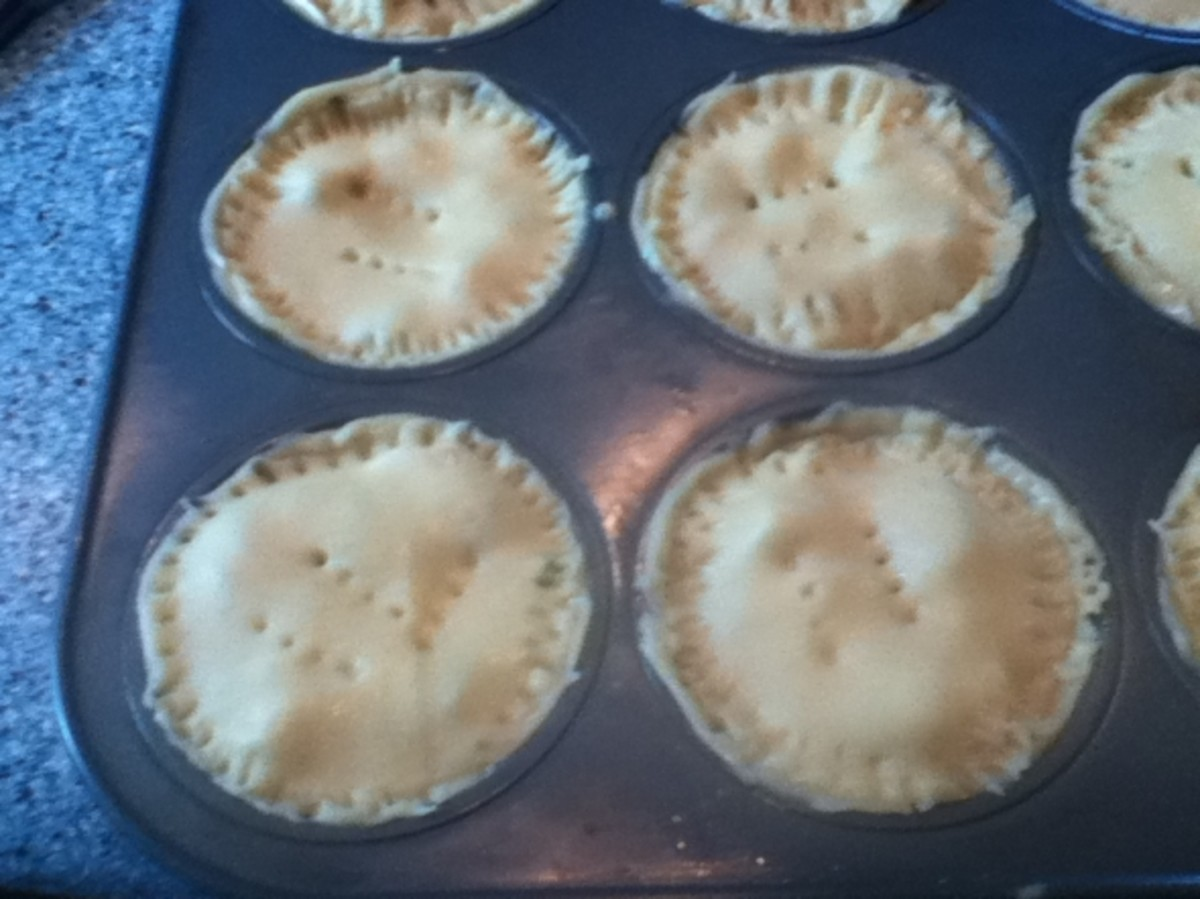 Pricking the tops of the chicken pot pies pre-baking