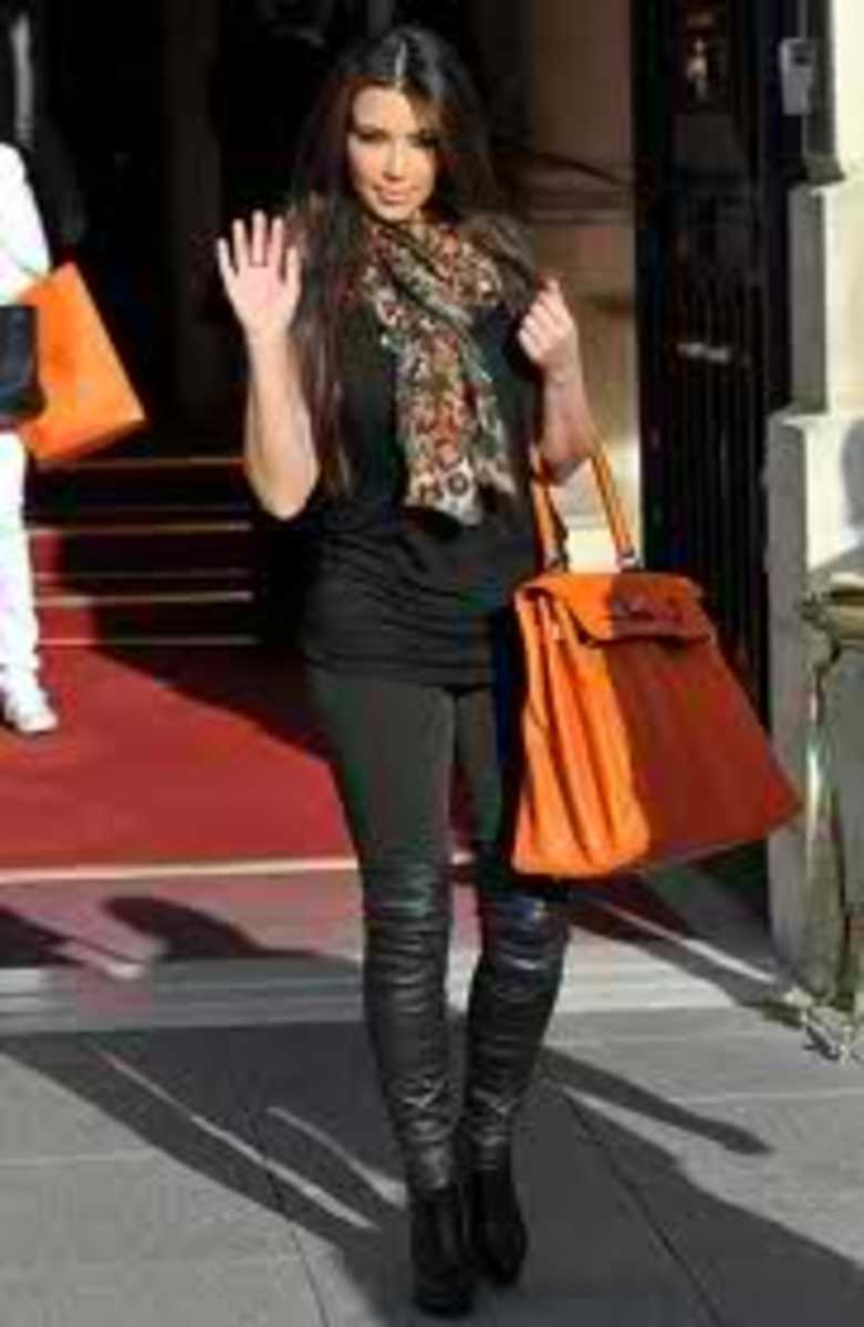 Here's Kim pictured again with a  halloween tan birkin with gold hardware.
