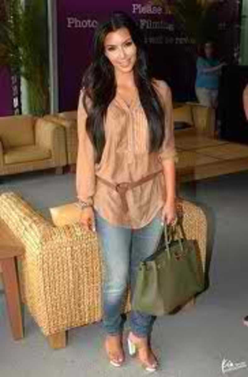 Here's Kim with another birkin bag in Olive. This is rare but gorgeous.