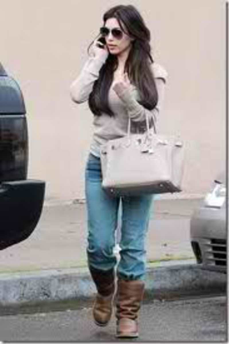 Kim in her fabulous light gray Birkin bag.