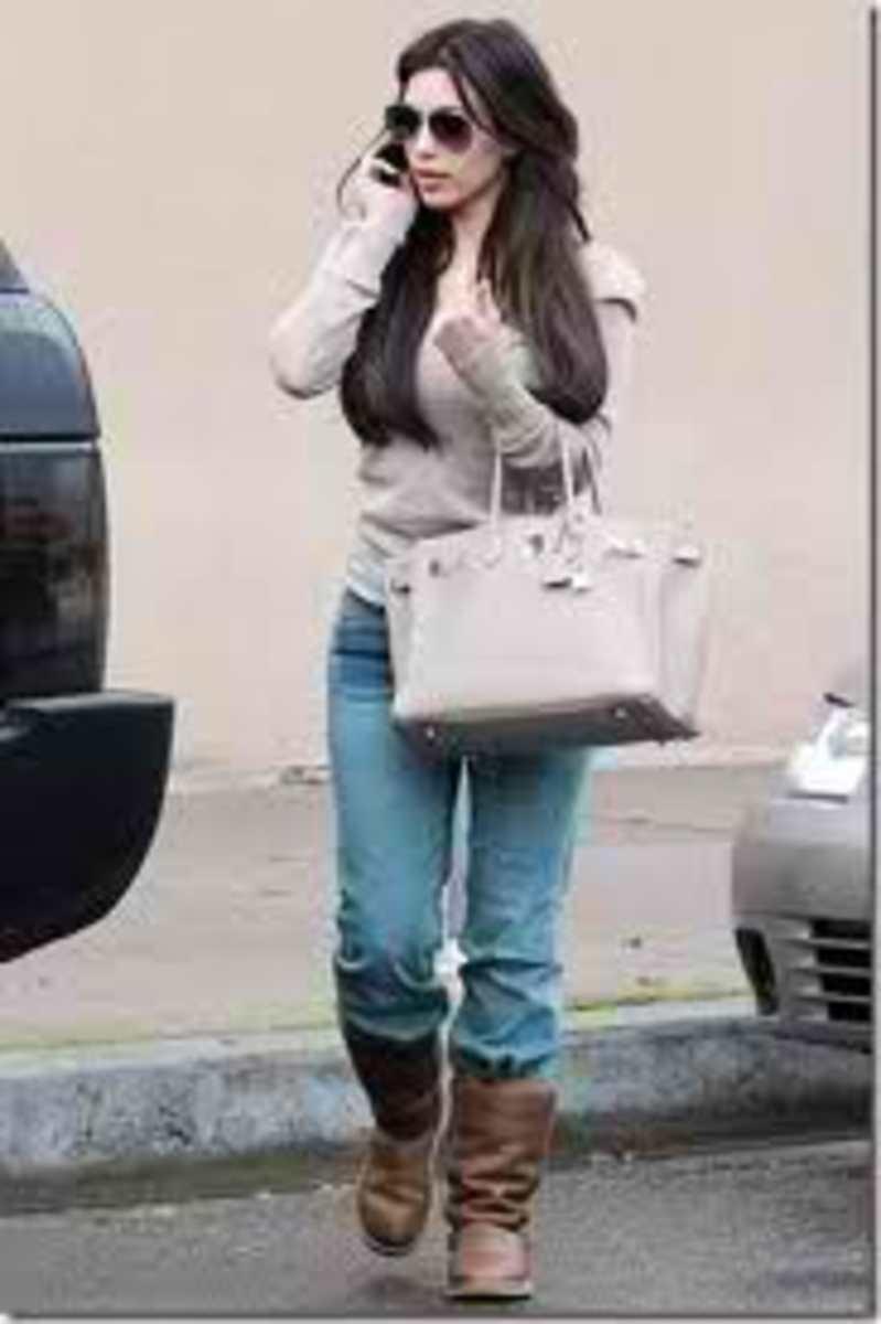 Kim in her fabulous light gray Birkin bag.